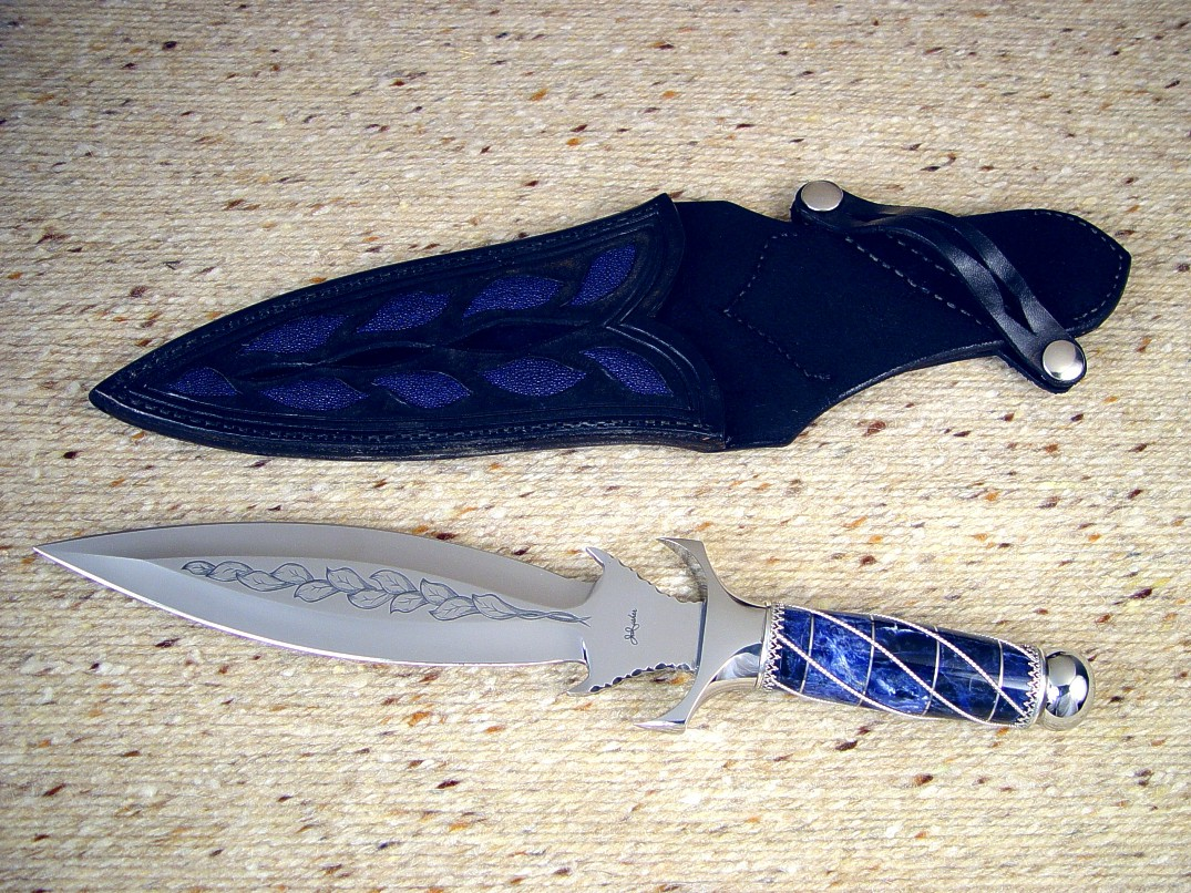 """Amethystine"" obverse side view: hand-engraved 440C high chromium stainless steel blade, 304 stainless steel guard and pommel, sterling silver wire wrap and ferrules, Sodalite Gemstone handle, blue Stingray skin inlaid in hand-carved leather sheath"