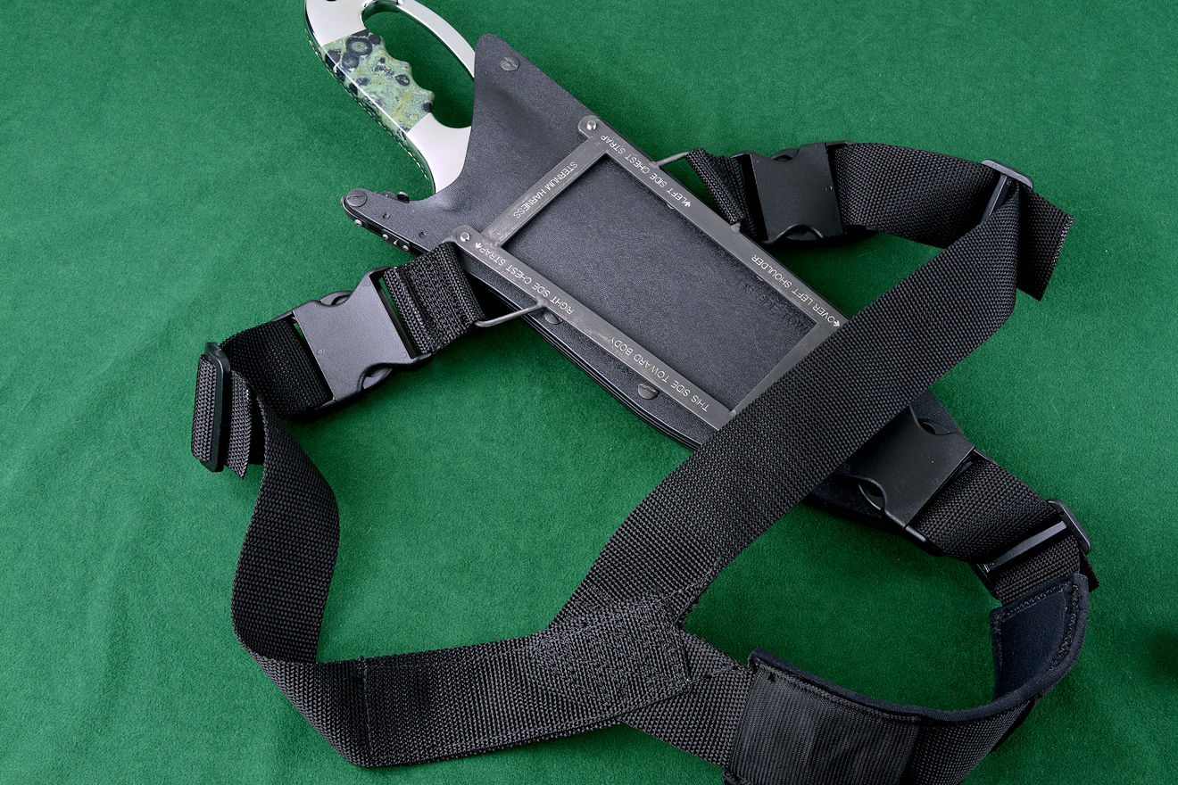 """Ananke"" custom tactical knife, module frame for sternum harness shown attached to sheath"