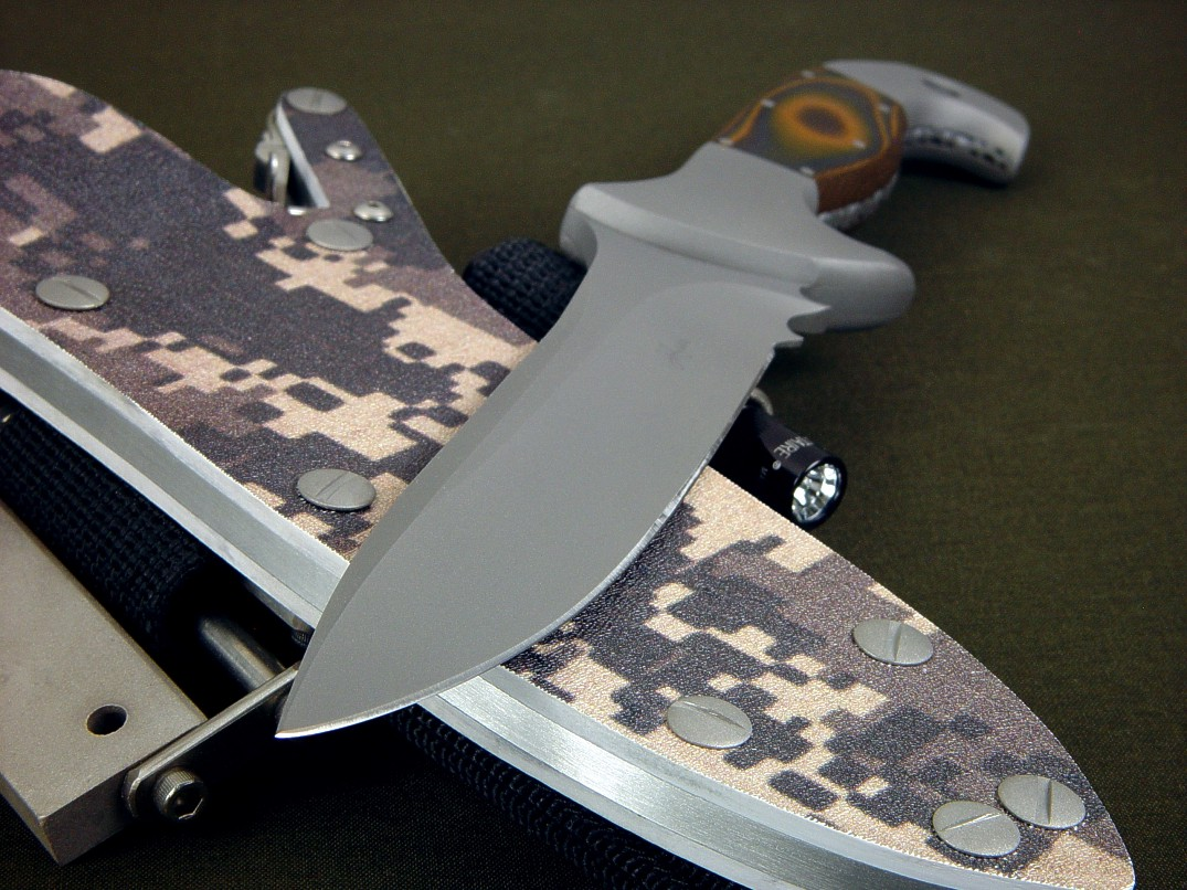 """Anzu"" fine combat, tactical knife, obverse side view in CPMS30V high vanadium tool steel blade, 304 stainless steel bolsters, Tiger Stripe G10 fiberglass epoxy laminate composite handle, digi-camo desert kydex locking sheath with ultimate extender package and accessories"