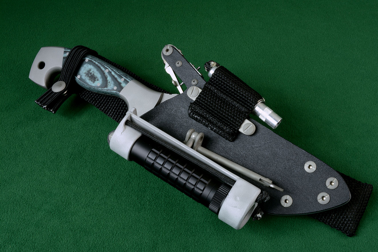 "The HULA with a MagTac flashlight on this ""Arctica"" tactical combat, rescue, survival knife."