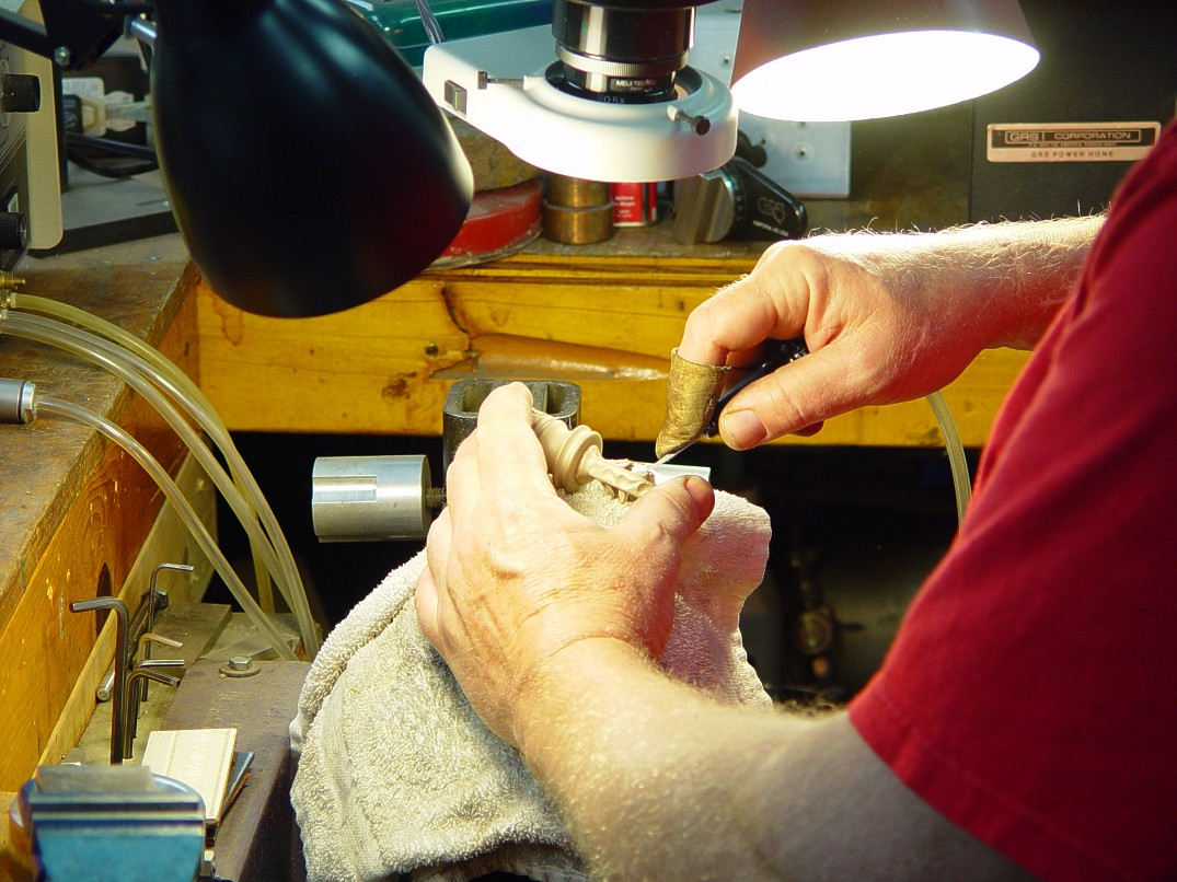 Hand-engraving cast bronze pommel made in-house