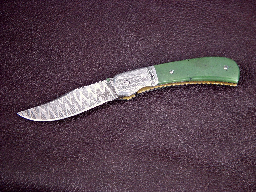 """Gemini"" obverse side view: vinland pattern welded damascus blade and bolsters, Green Siberian Jade gemstone handle, anodized titanium liners"