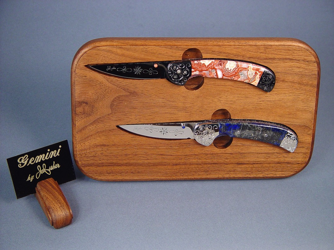 """Gemini"" Twins: linerlock folding knives in blued steel, stainless steel, hand-engraved, Lace Agate, Lapis Lazulii gemstone, anodized titanium, American Black Walnut, Paduk hardwood"