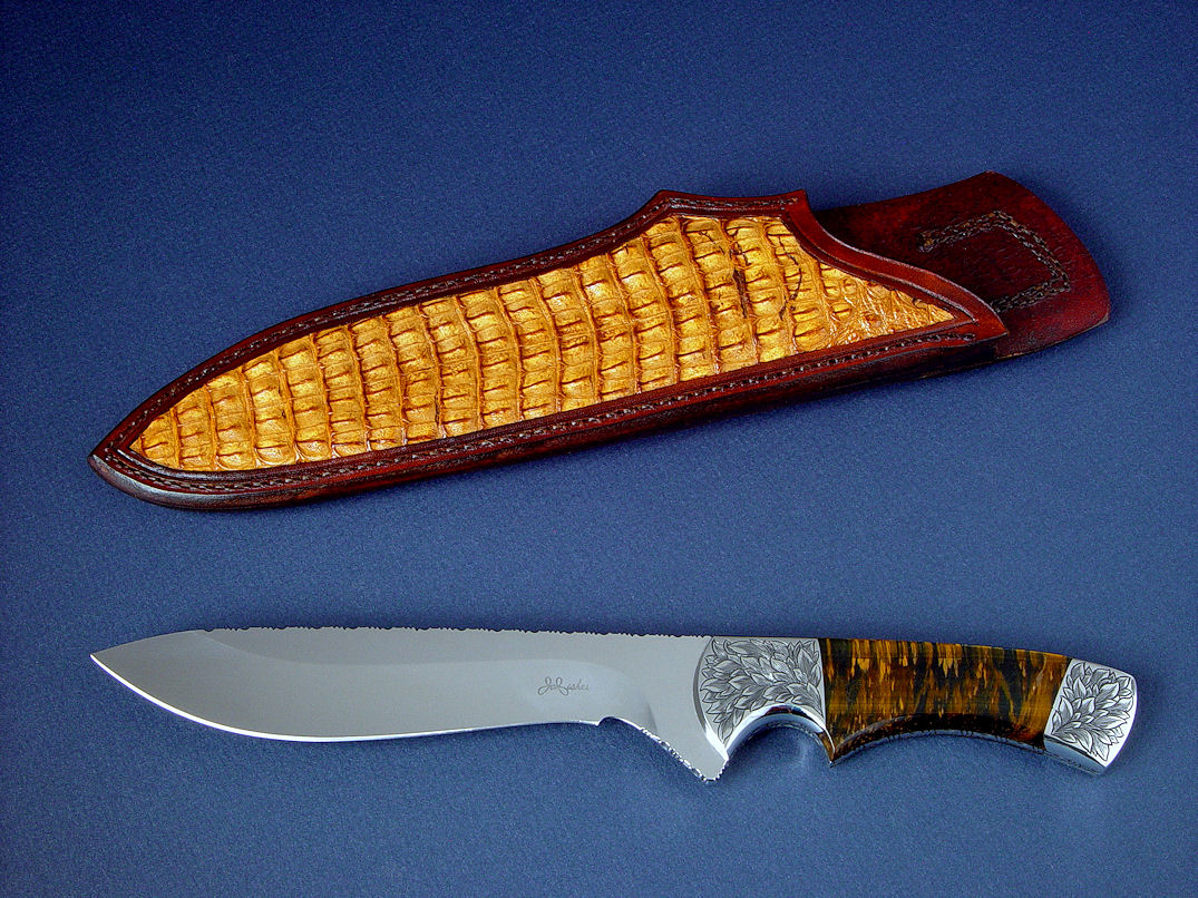 """Golden Eagle"" obverse side view in CPM154CM high molybdenum powder metal technology tool steeel blade, hand-engraved 304 stainless steel bolsters, Bicolored Tiger Eye gemstone handle, Caiman skin inlaid in hand-carved leather sheath"