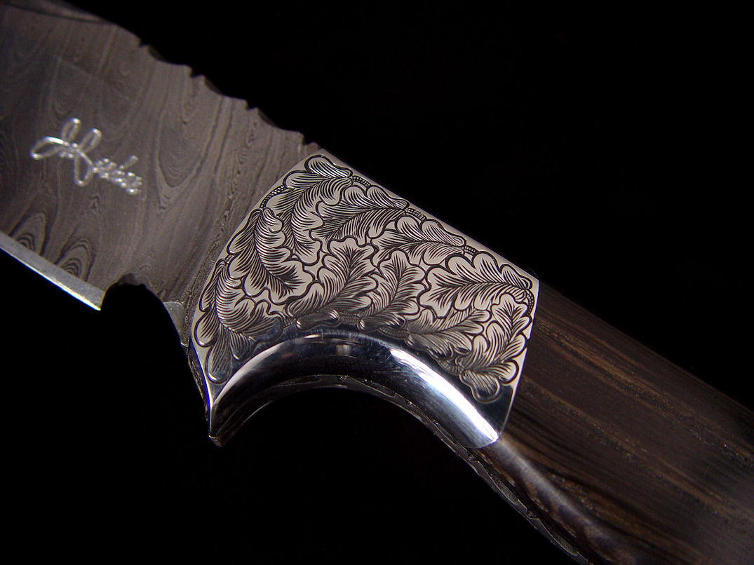 """Morta"" obverse side front bolster detail. Bolsters are hand-engraved 304 high nickel, high chromium stainless steel"