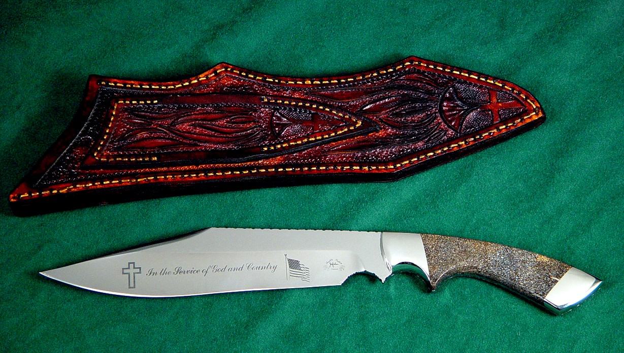 Veteran's knife honoring Major Thomas Shuman: veteran of three wars. Etched 440C high chromium stailess steel blade, 304 stainless steel bolsters, petrified dinosaur bone gemstone handle, hand-carved leather sheath