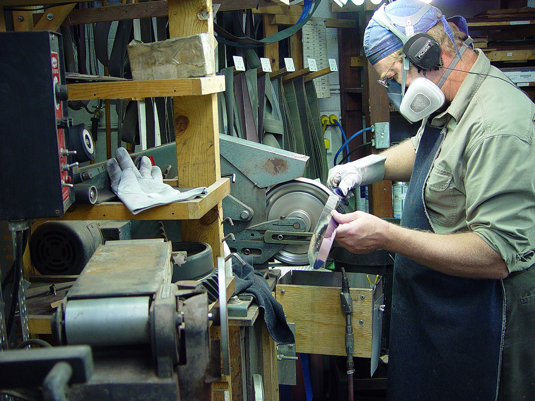 Jay Fisher hollow grinding a large broadsword offhand to mirror polish