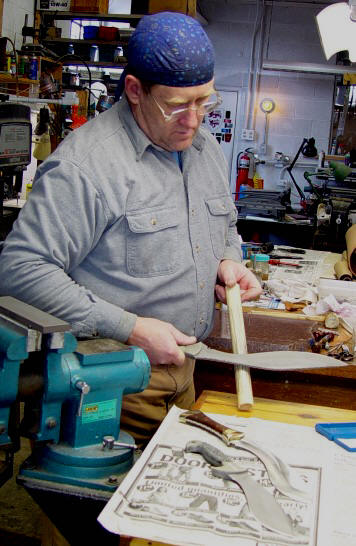 Sharpening the inside curve of a khukri blade, using a ceramic tube