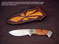 "Collector's grade custom handmade knife: ""Chama"" in 440C stainless steel blade, hand-engraved carbon steel bolsters, copper ore gemstone handle, emu skin inlaid in leather sheath"