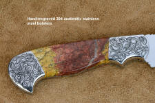 """Aldebaran"" obverse side bolster engraving detail in CPM154CM high molybdenum powder metal technology stainless steel blade, hand-engraved 304 stainless steel bolsters, Sunset Jasper gemstone  handle, hand-carved leather sheath inlaid with ostrich leg skin"