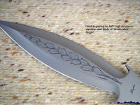 "Hand-engraving on ""Amethystine"" dagger, on blade flat (spine) in 440C high chromium stainless tool steel"