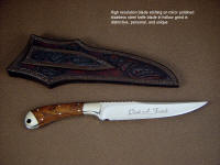 Personal embellishment, name, font, and text etched on hollow ground custom knife blade