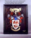 "Coat of arms, backboard and frame for ""Warrior's Quill rapier and parrying dagger. Board is embellished with machine cut and engraved anodized aluminum and lacquered brass mosaic on antiqued oak handmade frame"