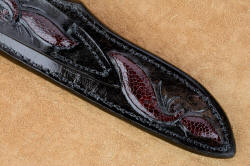 """Aldebaran"" sheath lower back detail. Full hand carving and inlays of burgundy ostrich leg skin, sealed with acrylic for resistance to elements"