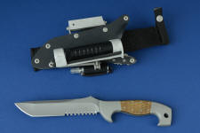 """Arctica"" tactical, combat, rescue, survival knife, obverse side view in CPMS30V high vanadium powder metal technology tool steel blade, 304 stainless steel bolsters, Thunderstorm kevlar with brass handle, locking kydex, aluminum, stainless steel sheath with ultimate belt loop extender and all accessories"