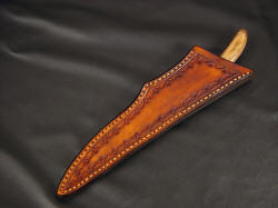 """Boning"" custom chef's knife, sheathed view. Sheath is deep and protective, hand-stitched, lacquered and sealed"
