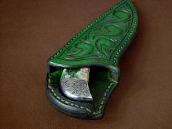 """Bootes ST"" sheath mouth view. To remove knife, push down on butt welt and pull knife."
