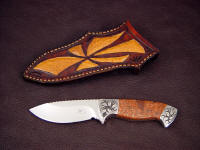 """Chama"" obverse side view in 440C high chromium stainless steel blade, hand-engraved low carbon steel bolsters, copper ore, hecla, calumet handle, Emu skin inlaid in hand-carved leather sheath"