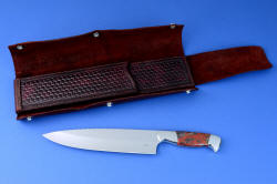 """Concordia"" master chef's knife, obverse side, open chef's roll view. Interior heavy sheath with outer wrap of latigo leather secures knife  with safety and beauty"
