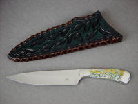 """Cygnus"" obverse side view in 440C high chromium stainless steel blade, 304 stainless steel bolsters, Orbicular Jasper gemstone handle, hand-carved, tooled, and laced leather sheath"