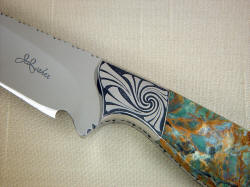 """Eridanus"" obverse side front bolster detail. This photograph is a four power enlargement of the knife. Note sculpted front bolster face, swirling and bold engraving pattern."