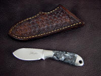 """Firefly""obverse side view in ATS-34 high molybdenum stainless steel blade, 304 stainless steel bolsters, Larvikite gemstone handle, hand-stamped leather sheath"