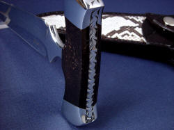 """Grim Reaper"" spine view. Handle is bedded, locked under dovetailed 304 stainless steel bolsters."