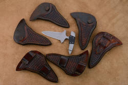 Assortment of Guardian sheaths in brown basketweave leather, both horizontal and vertical, for both left side and right side, front and back wear