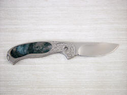 Izar liner lock folding knife reverse view, gemstone handle inlay, interframe