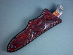 """Izar"" custom handmade knife sheath view. The sheath is tough, thick leather shoulder, hand-carved and hand-stitched"
