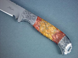 """Izar"" obverse side handle detail. Sunset Jasper has rusty reds, oranges, and yellows with black and agate seams"