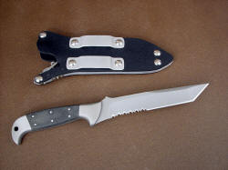 """PJLT"" collaborative knife, reverse side view. Note reversible belt loops in waterproof locking knife sheath"