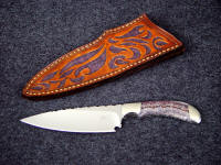 """La Cocina"" chef's knife, obverse side view in 440C high chromium stainless steel blade, 304 stainless steel bolsters, Lace Amethyst gemstone handle, hand-carved and tooled leather sheath"