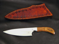 """La Cocina"" chef's, kitchen, knife obverse side view in 440C high chromium stainless steel blade, 304 stainless steel bolsters, Dymondwood (stabilized birch laminate) handle, hand-stamped leather sheath"