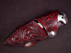 """Last Chance LT"" sheathed view. Sheath is tough and durable, nicely hand-carved, dyed, lacquered, and sealed. Knife is retained with welt stack at rear bolster and snap flap"