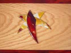 """Macha Navigator"" case top mosaic inlay detail. Mookaite Jasper gemstone inlaid in Red Oak with Redheart hardwood"