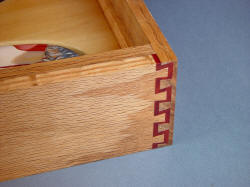 """Macha Navigator"" case joinery detial. Double dovetail in Red Oak and Redheart exotic hardwood, lacquered and sealed"
