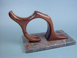 """Manaya"" sculptural stand hints at kneeled figure, hand carved in American Black Walnut, Red Oak, migmatite granite base"