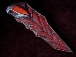 """Mercator"" sheathed view. Sheath is deep an protective, while displaying the handle in high-backed arrangement. Inlays are red rayskin and are very tough and hard. There are 12 inlays on the sheath front."