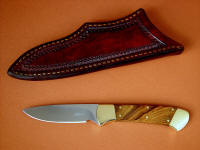 """Mirach"" obverse side view in satin finished 440C high chromium stainless steel blade, brass bolsters, African Sandalwood hardwood handle, hand-tooled leather sheath"