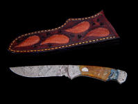 """Mizar"" obverse side in pattern welded O1 and A36 steel blade and bolsters, Pietersite agate gemstone handle, hand-carved leather sheath inlaid with tegu lizard skin"