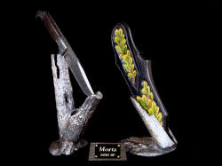 """Morta"" knife sculpture, left rear view. Knife and stand rest in complimentary hand-cast bronze stands"