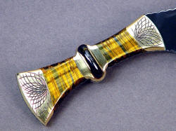 """Nasmyth"" khukri handle detail. The gemstones are beautiful and tough, with chatoyant light play and a complicated integrated central palm ring in gemstone with a full tang blade"