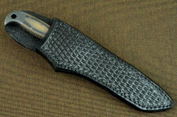 """PJLT"" sheathed view, leather sheath. Wearer is protected from blade with heavy welts, handle is accessible and fast to unsheath"