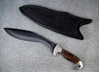 """Phlegra"" Khukri, Obverse side view: bead blasted, hot blued O-1 high carbon tungsten vanadium tool steel blade, 304 stainless steel bolsters, Ziricote exotic hardwood handle, hand-tooled leather sheath"