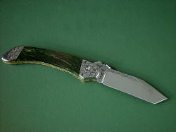 """Procyon"" reverse side view. Entire knife, blade, spine, fittings, bolsters, liners are all embellished throughout"
