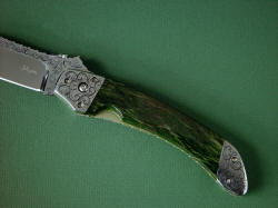 """Procyon"" obverse side handle detail. Handle scales are Pounamu, rare New Zealand greenstone, a Neprite Jade that is tough and solid."