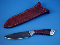 """Rio Grande"" obvers side view in blued O1 high carbon tungsten-vanadium alloy tool steel blade, hand-engraved 304 stainless steel bolsters, Honduras Rosewood Burl hardwood handle, hand-stamped basket weave leather sheath"