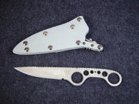 """Shank"" obverse side view, tactical knife in ATS-34 high molybdenum stainless steel blade, milled and bead blasted, locking kydex, aluminum, stainless steel, blued steel sheath"