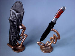 """Tharsis Intense"" view from elevated position shows varied appearance of this sculptural form of knife, sheath, and art."